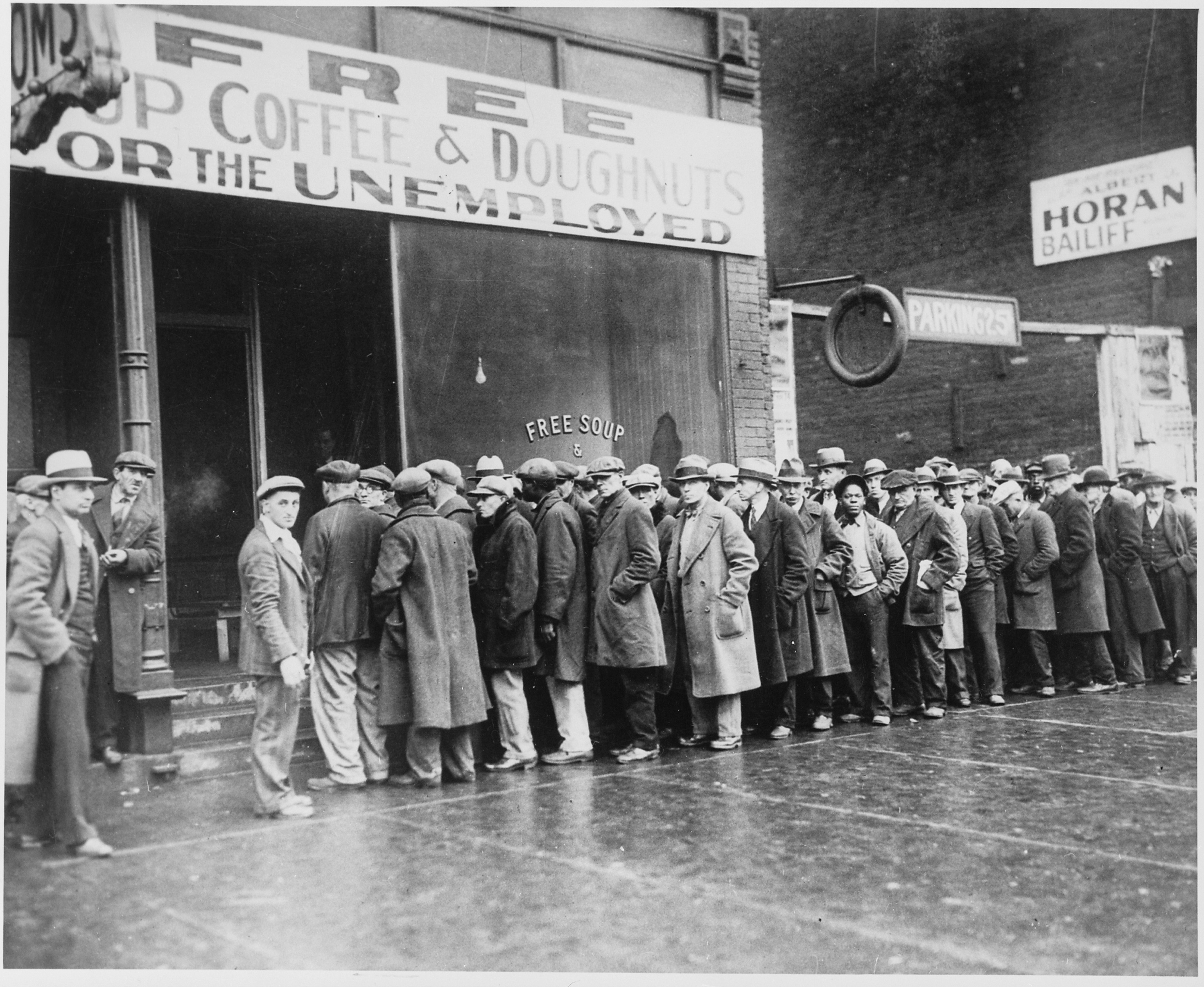 Unemployed_men_queued_outside_a_depression_soup_kitchen_opened_in_Chicago_by_Al_Capone_02-1931_-_NARA_-_541927.jpg#asset:45634